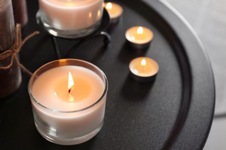 Burning,Wax,Candles,On,Dark,Table